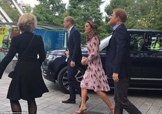 The Duchess of Cambridge looked surprisingly summery today in a pink rose print dress by Temperley London for a day of engagements in London