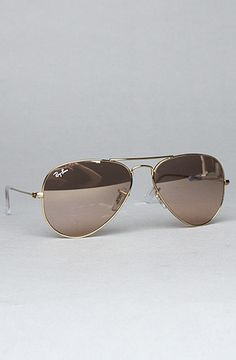 0c202f65d30 I need to start wearing my contacts so I can FINALLY get a pair of cute  sunglasses! The Aviator Large Metal Sunglasses in Brown and Pink by Ray Ban