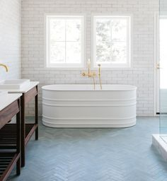 refined in format and rustic in texture, modern farmhouse brick tile is the perfect blend of functionality and simple. it's a matte finish, bright white brick with slight color variation. this glazed brick is the perfect substitute for a classic subway tile, providing a little more texture without any gloss. paired here with our basil rectangle cement tile. #brick #cement #tiles #bathroomdesign