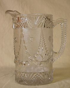 """EAPG """"Festoon"""" Pattern Water Pitcher Jug made by the Portland Glass Co. circa 1890-1900, 8.5""""H x  7 3/8""""W spout to handle, 4.5""""D of base."""