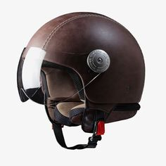 Made of extra-tough ABS plastic with a genuine, scratch and water-resistant leather cover and breathable, anti-allergen velvet lining, the Vintage Brown Leather Helmet offers the perfect pairing of safety and style. Cool Motorcycle Helmets, Racing Helmets, Cool Motorcycles, Vintage Motorcycles, Bicycle Helmet, Motos Vintage, Vintage Helmet, Scooters, Moto Cafe