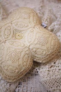 ring pillow from an antique lace, and an antique mother of pearl button in the center of it