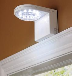 Motion Sensor Entry Light - runs on batteries. Great for when you know you are coming home late but don't want to attract moths by keeping the regular porch light on Entry Lighting, Closet Lighting, Outdoor Lighting, Chandeliers, Entry Closet, Home Gadgets, Home Automation, Smart Home, Home Organization