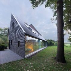 Barend Koolhaas completes a blackened timber  house with a triangular floor plan