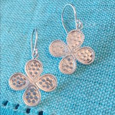 Anna Beck clover sterling silver earrings These are beautiful sterling silver clover shaped Anna Beck earrings! I collect her pieces but find that I wear bigger jewelry so that means I'm cleaning out my smaller pieces! I've never actually worn them but I no longer have the original box. Anna Beck Jewelry Earrings