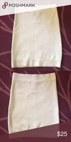 🌟BCBG Maxazria Bandage Mini Skirt Off White New without tags. Size medium. 72% rayon 27% nylon 1% spandex BCBGMaxAzria Skirts Mini
