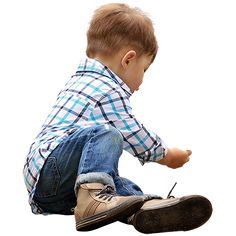 A toddler playing on the ground in designer clothes.