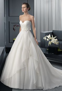 Brides: Two by Rosa Clará. Organza dress with beaded flower in a natural color.