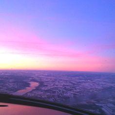 Sunrise over a frozen Maine landscape