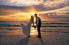 Can it get any more romantic?  Sunset wedding at the Sandbar photo courtesy of Dara Caudill http://www.IslandPhotography.org