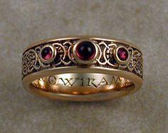 8th to 9th century Celtic wedding band with bezel set cabochon garnet stones.