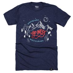 """The Stately Type Go West t-shirt features the hand-lettered phrases """"Go West,"""" """"Adventures Awaits,"""" and """"Never Stop Exploring"""" on a navy blue poly-cotton tee."""