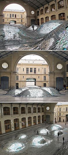"""WasteLandscape"" is made by creative artist Elise Morin and architect Clemence Eliard. The ""WasteLandscape"" consists of 65,000 old CDs that are gathered from recycle waste and gone through a creativity treatment, giving an impression of rising and falling waves on 500 square meters."