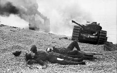 "WWII --- Aftermath of the failed ""Dieppe Raid"" against German-occupied France. Wounded Canadian soldiers lie next to a disabled Mk IV ""Churchill"" tank, as a landing craft burns in the background. Canadian Soldiers, Canadian Army, Canadian History, British Army, British Tanks, Churchill, Dieppe Raid, British Commandos, Landing Craft"