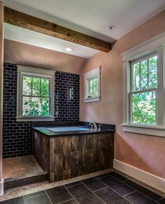 "japanese soaking tub: ceramic ""faux"" wood, leathered granite, indigo blue subway tile, by Marcelle Guilbeau, via Flickr"
