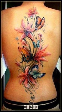 Beautiful butterfly and flowers back tattoo.