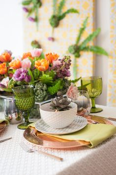 This dessert inspired tablescape is one of a kind. Make your wedding unique by thinking of an alternative reception theme. Have fun with vibrant summer colors. Elegant tableware and green foliage make a statement here. #weddingpaperdivas #weddinginvitations #party #venue