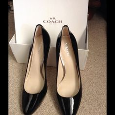 COACH Patent Leather Platform Pumps Gorgeous black pumps with silver Coach logo at back heels. NWT. Pristine. Comes with original box and dust bag. Coach Shoes Heels
