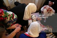 Bulgarian Muslim, Letfe Mekerozova (C) is attended to by unidentified persons during her two day wedding ceremony 06 January 2008 in the village of Ribnovo some 210 km from the capital Sofia. AFP PHOTO / BORYANA KATSAROVA (Photo credit should read BORYANA KATSAROVA/AFP/Getty Images)