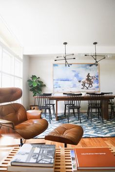 Brown Eames Chair | Blue Pattern Rug | Exposed Bulb Chandelier