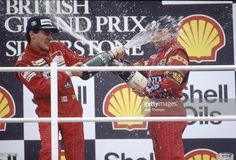 July 1988 British Grand Prix at Silverstone Brazil's Ayrton Senna left winner celebrates with the traditional champagne soaking with place Nigel. Nigel Mansell, British Grand Prix, F1 Drivers, Formula One, His Eyes, Fast Cars, Great Britain, One Pic, Brazil