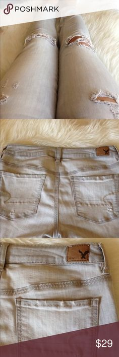 American Eagle distressed light grey denim jeans Used and in good condition. Only sellling because I bought them right after my last pregnancy and now are too big on me. Great fit by a well know brand! I have posted a bunch of my size 10 jeans and shorts, scroll through to view other adds. American Eagle Outfitters Jeans Skinny