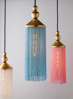This Scarlett pendant light obscures its bulb with flapper-like fringe in fun colors, making it a boho chic shoe-in. Gold leaf ups the glamour and its black woven cord make it a very neat pendant. Hang one alone or suspend them in clusters—make your bohem Ramadan Decoration, I Love Lamp, Higher Design, Hudson Valley Lighting, Home Lighting, Lighting Ideas, Pendant Lighting Bedroom, Chandeliers, Jar Chandelier