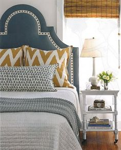 love the headboard color against the white walls