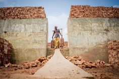 A brickyard worker hauls bricks in Bangladesh in this National Geographic Your Shot Photo of the Day. Trending Photos, Shot Photo, World Photo, 2017 Photos, National Geographic Photos, Our World, Your Shot, Yahoo Images, Land Scape