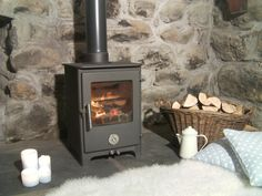 The Short Penguin looks great in charcoal as seen here, but is also available in traditional black or for a bit more colour almond, red, green or blue. Rated at 5 kW's this little stove will help keep you nice and cosy in the Winter. Available with an optional log store.