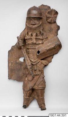 Warrior chief wearing the coral-bead collar, leopard-tooth necklace, quadrangular bell, sword, and shield assosiated with warriors. Late 17th century. (Staden-Benin) - National Museums of World Culture, Gothenburg, Sweden