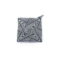 Origami Purse  A striking, hand screen-printed geometric coin purse in black and cream, with shiny gold lining. Carry your pennies in style!    Audrey Roger is a London-based textile designer whose hypnotic geometric patterns are inspired by Op Art, African art and origami.