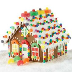 The enchanted gingerbread chalet has candy decorations everywhere you look…on the roof, around the doors and windows and along the sidewalk. What a great centerpiece of magical creation to place on your holiday mantle.
