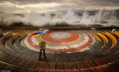 A boardwalk amphitheatre it his by waves and a storm whileAytul Akbastook this photo of his nephew in Kocaeli, Turkey