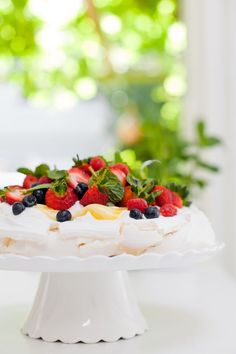 A showstopping pavlova topped with granadilla curd, whipped cream and fresh berries.
