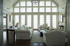 Those windows! Dark wood floors, light walls and lots of molding--very nice.