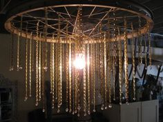 Bicycle spoke chandelier for the porch/deck/patio/out door garden room...
