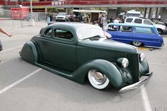 36 ford custom with cadillac sombrero hubcaps