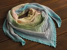 Crocheted shawl with the lace pattern is made with Scheepjes Whirl