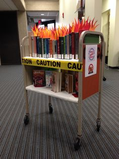 "Banned Books / Books on Fire / Books so hot Couldn't find link to source, only notes ""Display at University of Akron's Bierce Library for Banned Book Week 2013 "" School Library Displays, Middle School Libraries, Elementary Library, Library Signage, Library Programs, Library Science, Library Activities, Library Inspiration, Library Ideas"