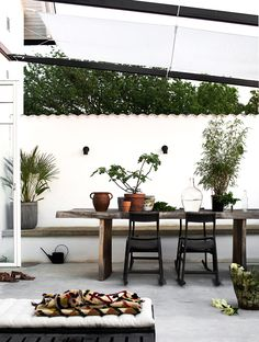 Bright, white, outside, outdoor, dining area, rustic table, recycled timber, victorian terrace.