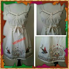 MERMAID CREAM DRESS Gorgeous needlepoint stitching along the bottom.  Elastic ruffled band around waist ties in front.  Buttons down bodice.  100% cotton.  No size listed on label.  Dress is modeled on size 6 mannequin. Anthropologie Dresses
