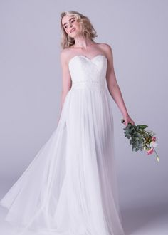 Bride&co wedding dress, Lace sweetheart bodice with soft mesh skirt and a delicate beaded belt. This is the perfect destination wedding dress.