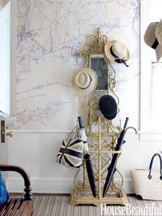 In the back hall, a Victorian hat rack stands against wallpaper charting the coast outside. Rug by Beauvais. Interior design by Tom Scheerer. Photo by Francesco Lagnese. South Shore Decorating, Foyer Decorating, Decorating Ideas, Interior Decorating, Decor Ideas, Welcome Design, Victorian Hats, Map Wallpaper, Coastal Wallpaper