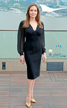 Shanghai Days from Angelina Jolie's Best Looks  While promoting Maleficent in Shanghai, Angie sports a flattering Michael Kors dress with sheer sleeves.
