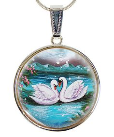 This Mother-Of-Pearl Swans In Love Round Pendant Necklace is perfect!  Following Russian and European traditions and creating their own aesthetic along the way, G. DeBrekht combines handcrafting with modern techniques to design unique, high-quality art and accents. Their carved and painted pieces make statements and heirloom-style gifts for special occasions, holidays or any day.