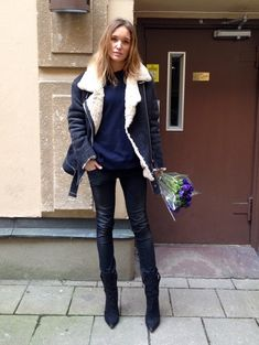 Caroline Sandstrom- Acne moto shearling jacket navy blue + blue sweater + black pointed mid calf boots