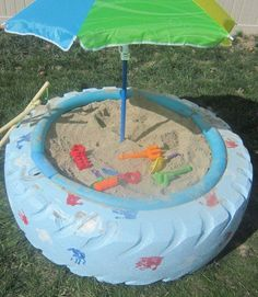 diy sandbox with an old tractor tire. Had this as a kid minus the umbrella, but it's a nice touch. Question now is where am I going to get a tractor tire. Backyard Projects, Diy Projects, Backyard Ideas, Backyard Seating, Backyard Beach, Upcycling Projects, Backyard Kitchen, Kids Crafts, Baby Crafts