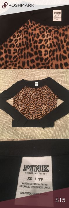 PINK VICTORIA SECRET CHEETAH TOP Black long sleeve top with cheetah print on front, somewhat cropped giving a fun and flirty vibe! Says pink I. White on back . Smoke free home fast shipping follow for more deals!! TAGS: VS VICTORIAS SECRET Cute PINK Victoria's Secret Tops Tees - Long Sleeve