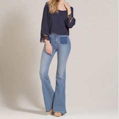 "Hollister Bell Bottom Vintage Look Denim Jeans Bell bottoms are making a serious come back this season. Be ahead of fashion trends and get these adorable vintage looking bell bottom jeans with a high rise waist. Comes to you brand new with tags. Waist: 14"", inseam 34"" and 10"" rise. The bell bottom (flare) measures 13"". Wear with a boho shirt or graphic tee and you'll be rocking that groovy fashion that's trending right now. NO PAYPAL TRADES Hollister Jeans Flare & Wide Leg"